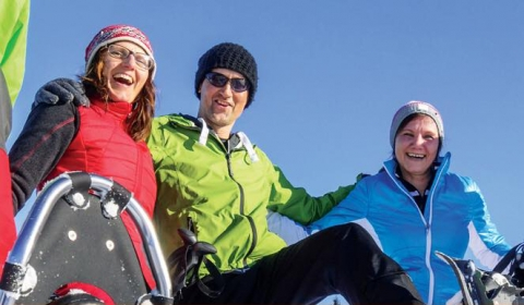 Adults snowshoeing
