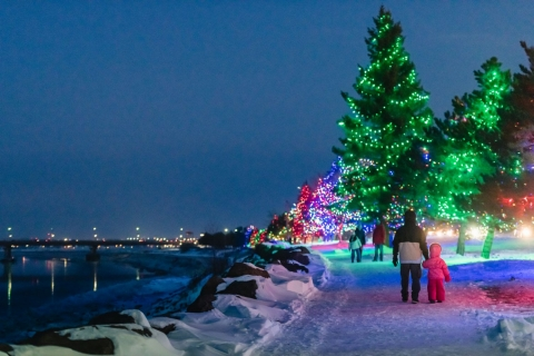 Families enjoy a walk on the glittering Riverfront Trail during Light Up Riverview.