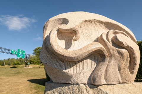 Stone sculptured entitled 'The Third Wave' by artist Julie Glaspy