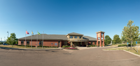 Wide-angle photo of Riverview Town Hall against a blue sky
