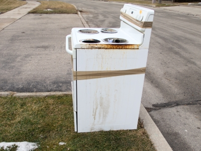 Damaged stove at curbside